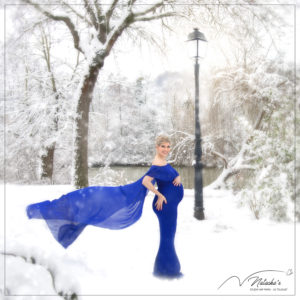 Shooting future maman sous la neige de Paris